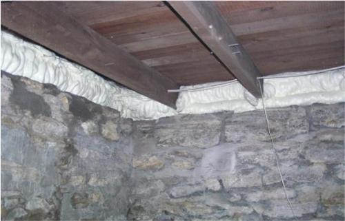 During a home cottage or commercial inspection in the Orillia, Gravenhurst,Bracebridge and Muskoka area we often find improperly installed vapour barrier.  Her we see the finished foaming over an old stone foundation in a crawlspace. An ideal use for the DIY spray foam kit.  a home cottage or commercial building.