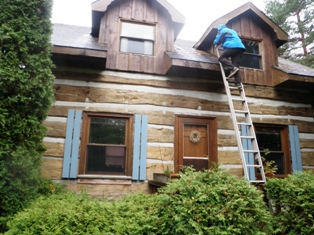 Muskoka home inspector checking log home roof
