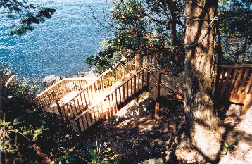 steep hillside  with well built and maintained stair set Very typical rocky steep lot in Muskoka, Port Carlng and Bala. All stairs should be subject to a home inspection.
