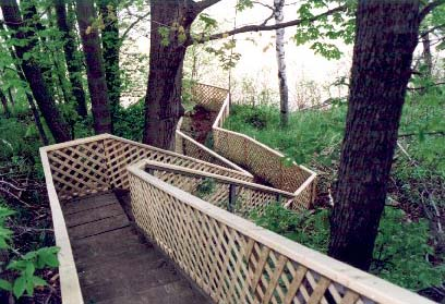 These stairs winding down a steep hillside need careful inspections.We risk our family members lives when we ignore construction and maintenance on this type of item around the home or cottage